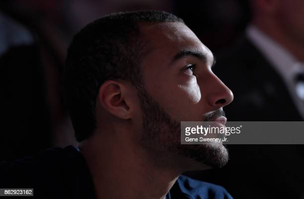 Rudy Gobert of the Utah Jazz looks on from the bench in the first half against the Denver Nuggets at Vivint Smart Home Arena on October 18 2017 in...