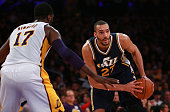 Rudy Gobert of the Utah Jazz looks to make a pass play as Roy Hibbert of the Los Angeles Lakers defends the play in the second half during the NBA...