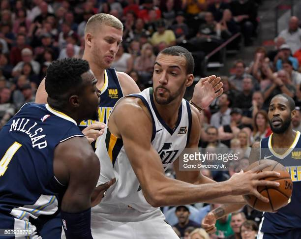 Rudy Gobert of the Utah Jazz looks to pass around Paul Millsap of the Denver Nuggets in the second half of the 10696 by the Jazz at Vivint Smart Home...