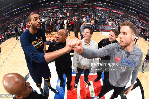 Rudy Gobert of the Utah Jazz meets with Blake Griffin of the LA Clippers before a game on March 25 2017 at STAPLES Center in Los Angeles California...