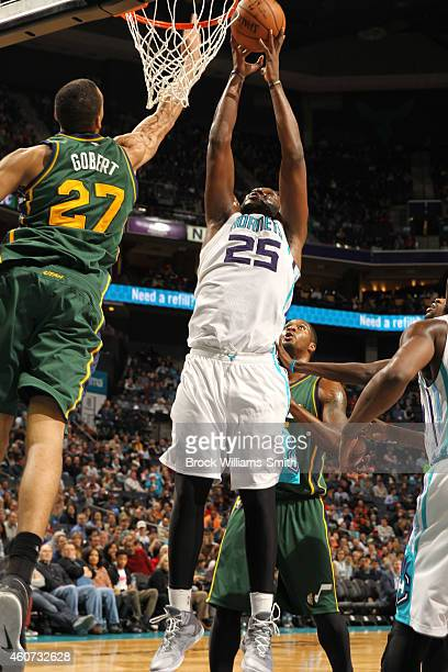 Rudy Gobert of the Utah Jazz on the block against Al Jefferson of the Charlotte Hornets during the game at the Time Warner Cable Arena on December 20...
