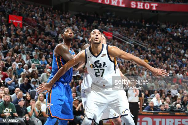 Rudy Gobert of the Utah Jazz plays defense against Paul George of the Oklahoma City Thunder during the game on October 21 2017 at vivintSmartHome...