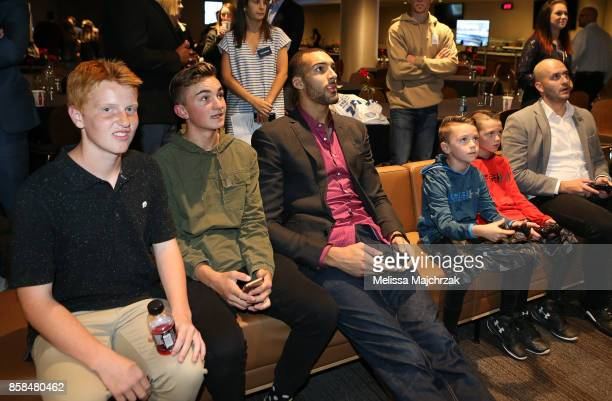Rudy Gobert of the Utah Jazz plays video games with young fans during Game Night with the Jazz at vivintSmartHome Arena on October 05 2017 in Salt...