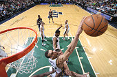 Rudy Gobert of the Utah Jazz reaches for the rebound against the Memphis Grizzlies during the game on April 10 2015 at EnergySolutions Arena in Salt...