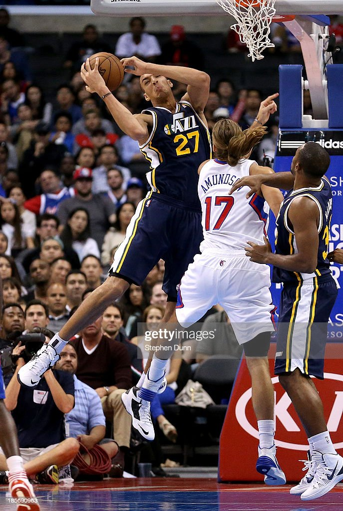 Rudy Gobert #27 of the Utah Jazz rebounds over Lou Amundson #17 of the Los Angeles Clippers at Staples Center on October 23, 2013 in Los Angeles, California. The Clippers won 103-99.