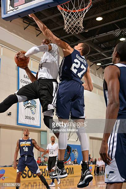 Rudy Gobert of the Utah Jazz rises to block a shot against the Brooklyn Nets during the 2013 Southwest Airlines Orlando Pro Summer League on July 10...