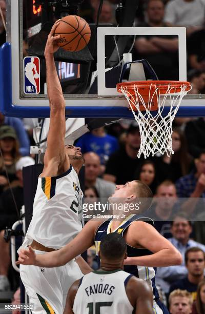 Rudy Gobert of the Utah Jazz scores over the defense of Nikola Jokic of the Denver Nuggets in the second half of the 10696 win by the Jazz at Vivint...