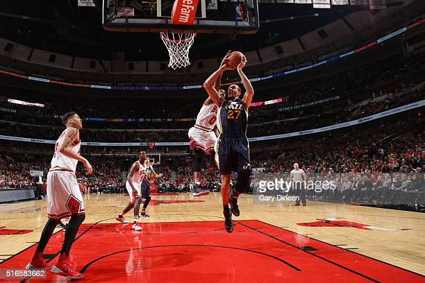 Rudy Gobert of the Utah Jazz shoots the ball against Aaron Brooks of the Chicago Bulls on March 19 2016 at the United Center in Chicago Illinois NOTE...