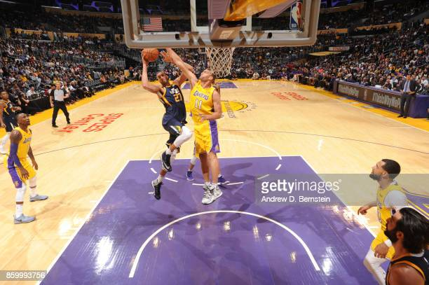Rudy Gobert of the Utah Jazz shoots the ball against Brook Lopez of the Los Angeles Lakers during a preseason game on October 10 2017 at STAPLES...
