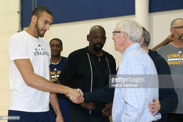 Rudy Gobert of the Utah Jazz speaks to former Head Coach Jerry Sloan during a press interview about the 1997 Reunited Western Conference Champs at...