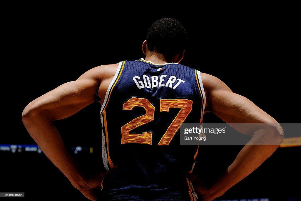<a gi-track='captionPersonalityLinkClicked' href=/galleries/search?phrase=Rudy+Gobert&family=editorial&specificpeople=7616046 ng-click='$event.stopPropagation()'>Rudy Gobert</a> #27 of the Utah Jazz stands on the court during a game against the Denver Nuggets on February 27, 2015 at the Pepsi Center in Denver, Colorado.