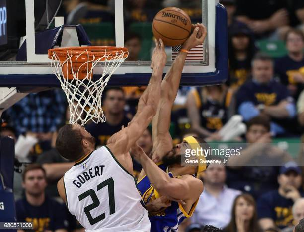 Rudy Gobert of the Utah Jazz tries for the block in the first half against JaVale McGee of the Golden State Warriors in Game Four of the Western...