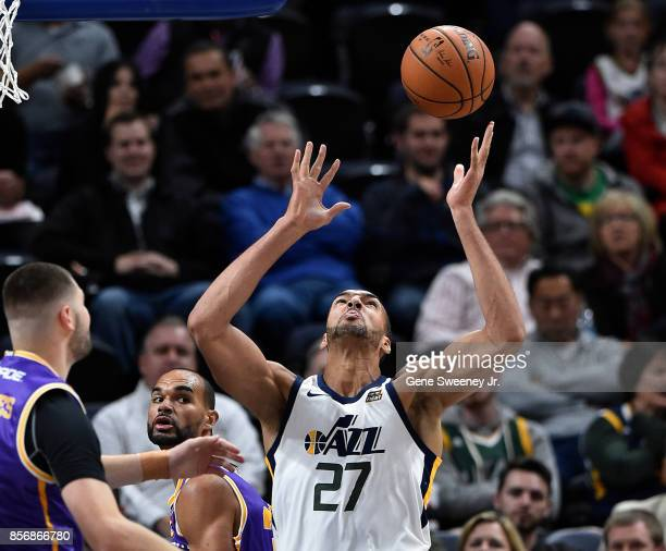 Rudy Gobert of the Utah Jazz tries for the loose ball in the second half of their 10883 preseason win over the Sydney Kings at Vivint Smart Home...