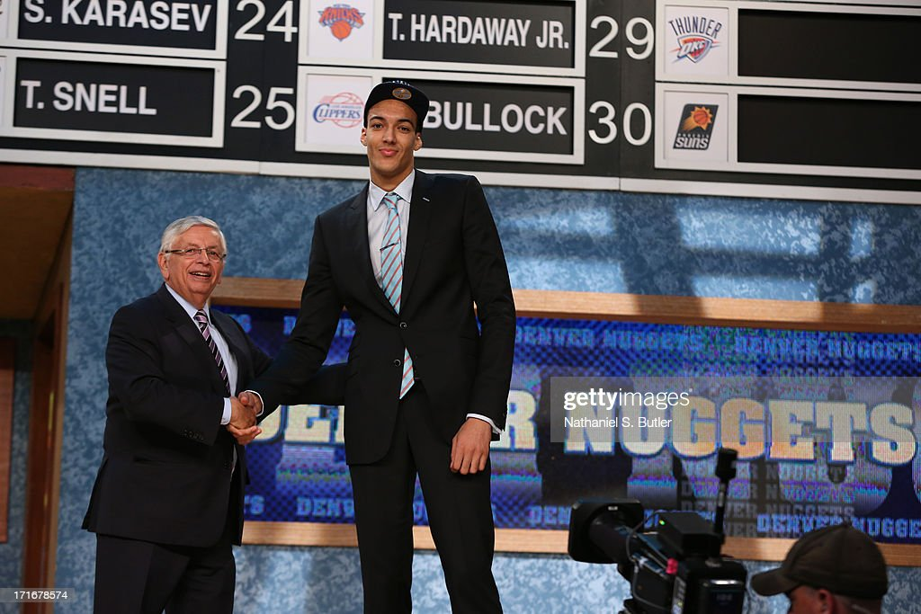 Rudy Gobert shakes hands with NBA Commissioner, David Stern after being selected number twenty seventh overall by the Denver Nuggets during the 2013 NBA Draft on June 27, 2013 at Barclays Center in Brooklyn, New York.