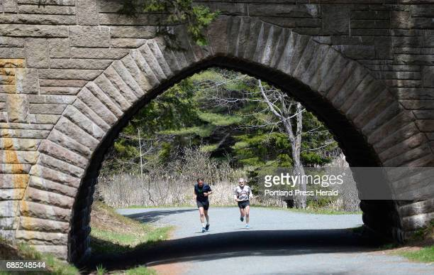 Rudy Kelley of Bernard right runs along the carriage trails in Acadia Nation Park with Steve Whalen of Bernard Saturday May 13 2017