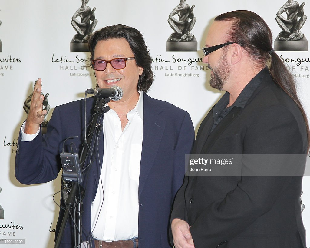 Rudy Perez and <a gi-track='captionPersonalityLinkClicked' href=/galleries/search?phrase=Desmond+Child&family=editorial&specificpeople=745873 ng-click='$event.stopPropagation()'>Desmond Child</a> attend Latin Songwriters Hall Of Fame announcement on January 28, 2013 in Miami, Florida.