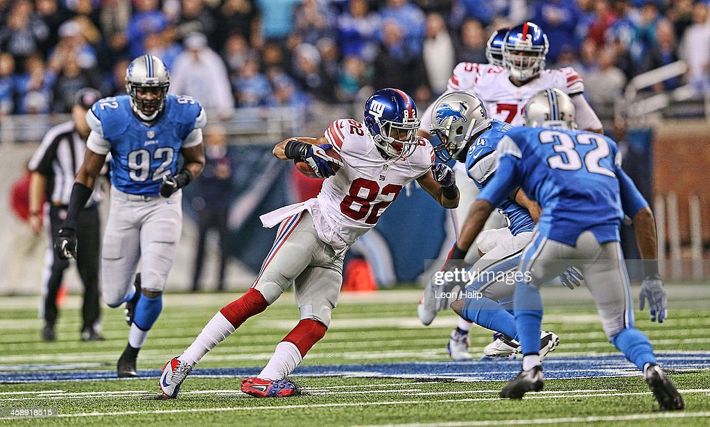 <a gi-track='captionPersonalityLinkClicked' href=/galleries/search?phrase=Rueben+Randle&family=editorial&specificpeople=6686464 ng-click='$event.stopPropagation()'>Rueben Randle</a> #82 of the New York Giants makes the catch for a 26 yard gain in ovetime during the game against the Detroit Lions at Ford Field on December 22, 2013 in Detroit, Michigan. The Giants defeated the Lions 23-20.
