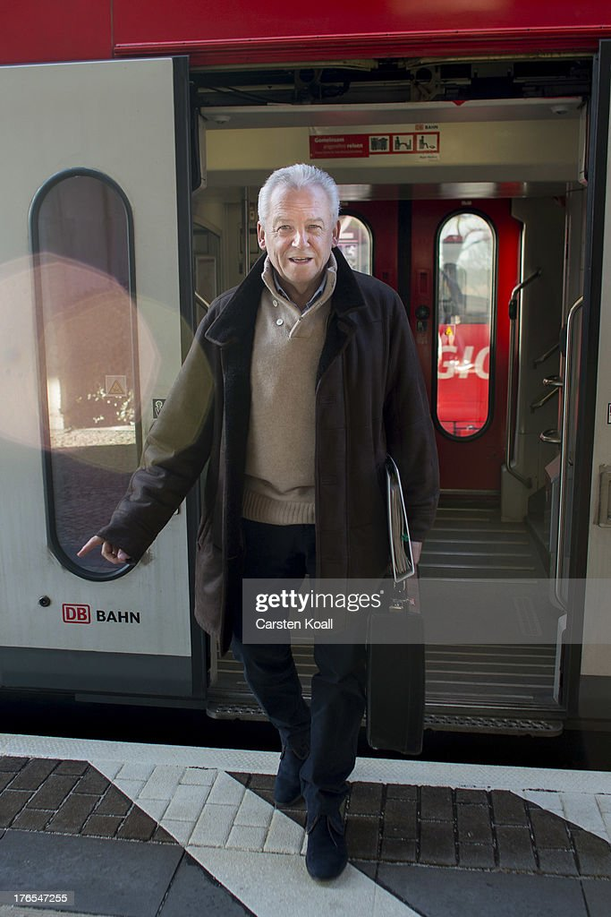 Ruediger Grube, CEO of Deutsche Bahn AG and DB Mobility Logistics AG, steps off the train after travelling by a Deutsche Bahn regional express train from Berlin to Potsdam on February 6, 2013 in Potsdam, Germany. Grube's predecessor, Hartmut Mehdorn, sought to privatise the state-owned rail carrier Deutsche Bahn, and was criticised for his cost-cutting efforts that left a disastrous legacy of insufficient investment in personnel and infrastructure.