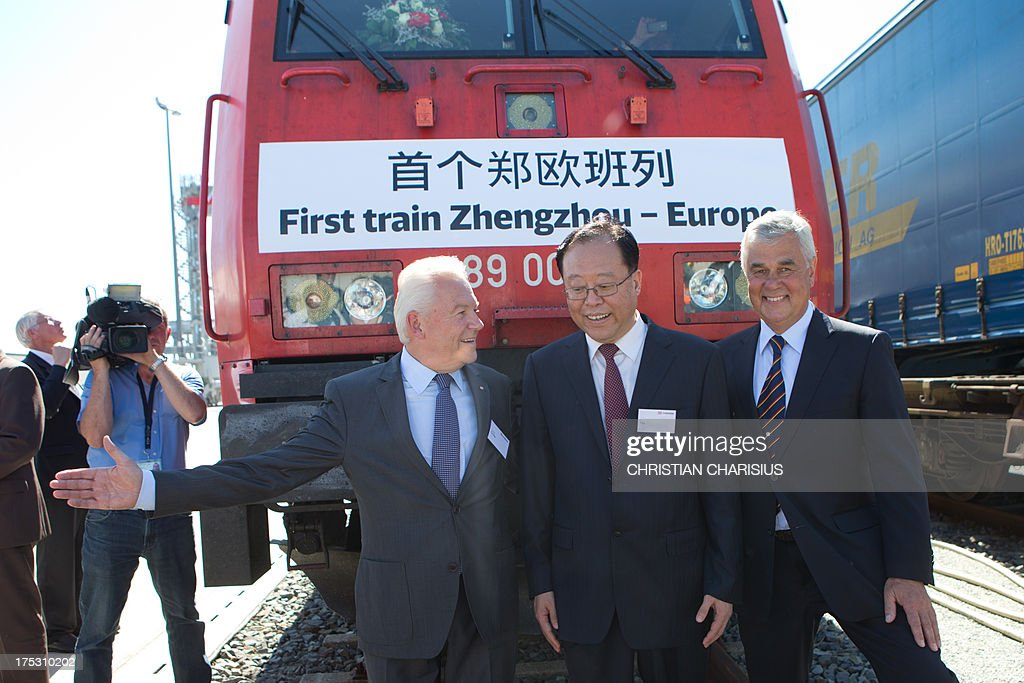 Ruediger Grube, CEO of German railway company Deutsche Bahn, Ma Yi, mayor of Zhengzhou and Frank Horch, Hamburg's economy minister pose in front of the first goods train arriving from the Chinese city of Zhengzhou at the DUSS container terminal in Hamburg, northern Germany on August 2, 2013. The train loaded with 51 containers arrived after a 15-day journey across 10,214 km at the railroad cargo transfer station Billwerder,Hamburg, announced DB Schenker, the freight subsidiary of Deutsche Bahn in Berlin on Friday, August 2, 2013.