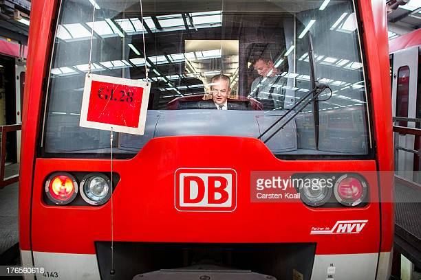 Ruediger Grube Chairman of German state rail carrier Deutsche Bahn looks through the window of the driver's cab drive vehicle of a SBahn train as he...