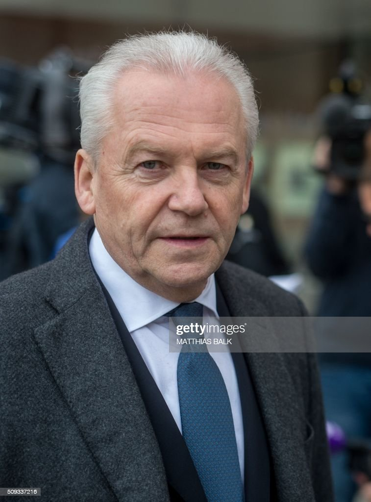 Ruediger Grube, chairman of Germany's railway operator Deutsche Bahn, gives a statement on February 10, 2016 in Bad Aibling, southern Germany, one day after a deadly train accident. Two Meridian commuter trains operated by Transdev on February 9, 2016 collided head-on near Bad Aibling, around 60 kilometres (40 miles) southeast of Munich, killing ten people and injuring around 80, police said. Investigators are probing whether an automatic braking system malfunctioned or whether there had been human error. / AFP / dpa / Matthias Balk / Germany OUT