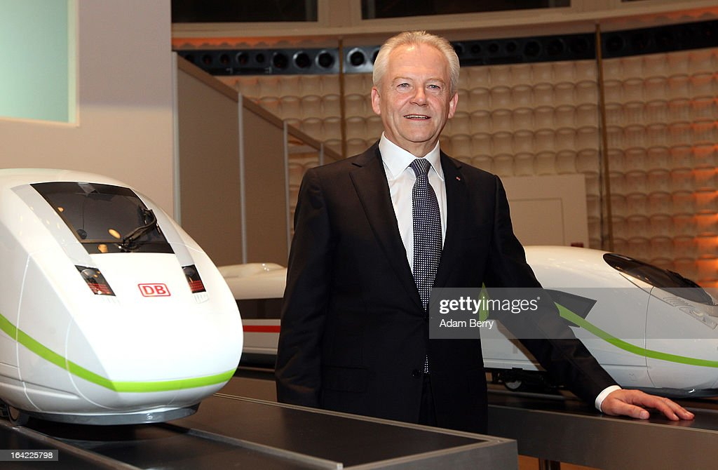 Ruediger Grube, chief executive officer of Deutsche Bahn, poses with models of InterCity Express (ICE) high-speed trains prior to the company's full-year earnings press conference on March 21, 2013 in Berlin, Germany. The state-run railway said that net profit increased by 11 percent last year to 1.48 billion euros (1.91 billion USD) thanks to increased passenger numbers, making it a record year for the company.