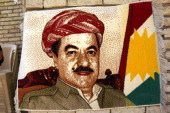 A rug made in the image of Kurdish leader Massoud Barzani is viewed in a market on July 3 2014 in Erbil Iraq On Thursday the president of Iraq's...