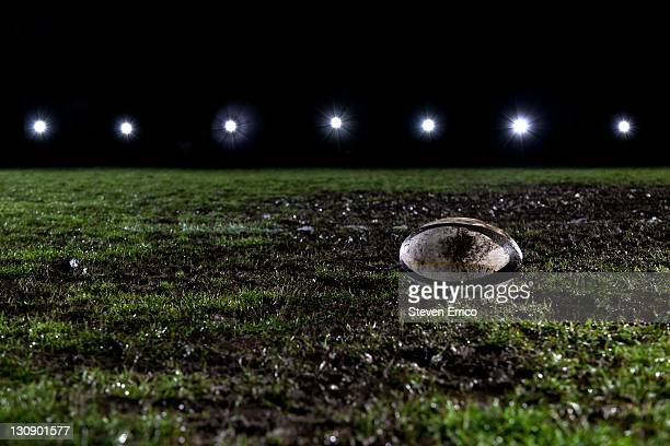 Rugby ball on muddy field