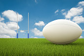 3d rendering rugby ball with rugby posts on field