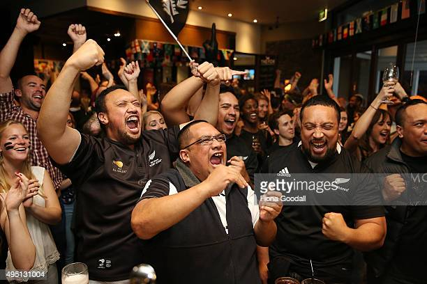 Rugby fans at The Fox Sports Bar in Auckland watch the 2015 Rugby World Cup Final match between the New Zealand All Blacks and Australia Wallabies on...