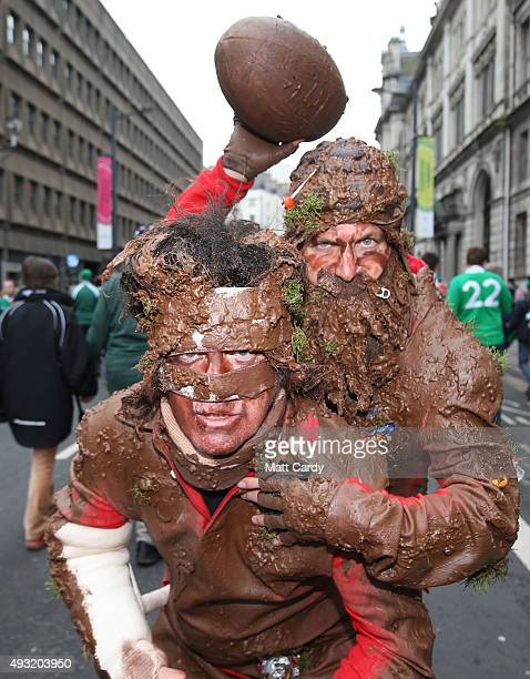 Rugby fans dressed as muddy players pose for a photograph close to the Millennium Stadium where Ireland are playing Argentina in the quarter finals...