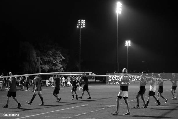 Gotham Knights RFC team carrying goal posts during practice session photo shoot at Randalls Island The team started in December 2001 as a...