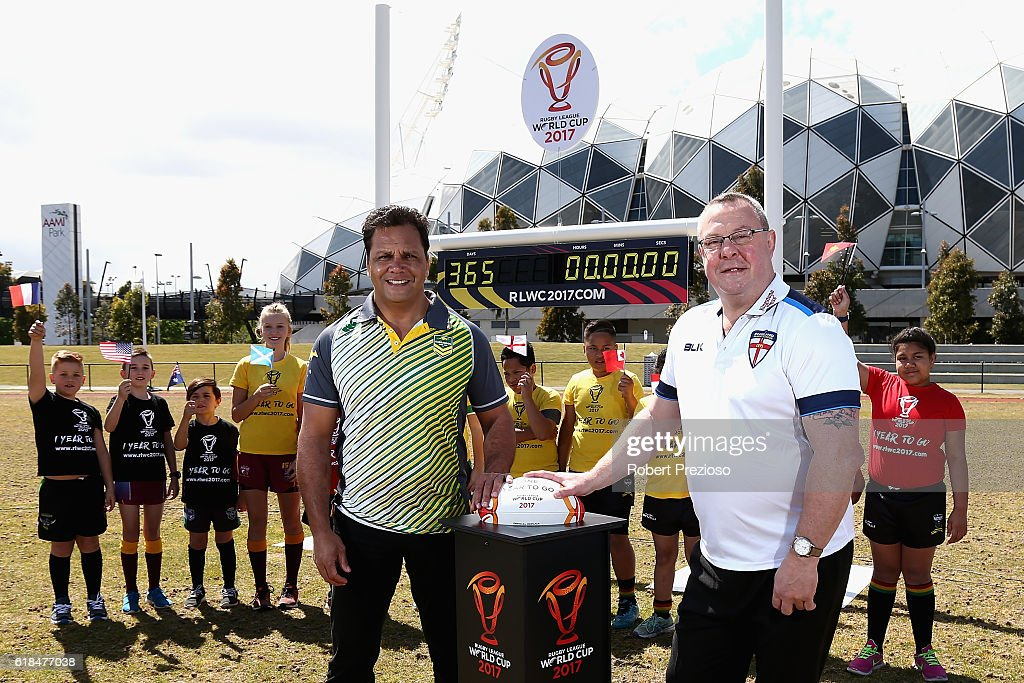 Rugby League legends Steve Renouf of Australia and Garry Schofield of Great Britain prepare to start the countdown clock during a media opportunity marking one year to go until the 2017 Rugby Leaguer World Cup next to AAMI park on October 27, 2016 in Melbourne, Australia.