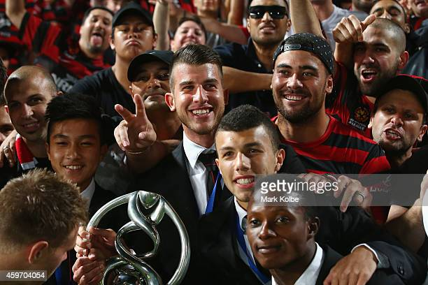 Rugby league player Andrew Fifita poses with the Wanderers players as they display the AFC trophy to the crowd during the round eight ALeague match...