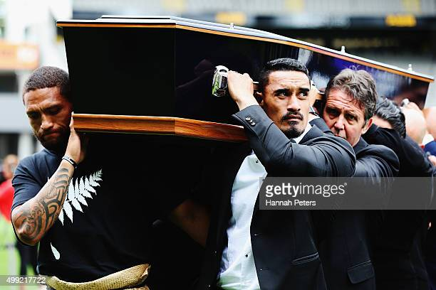 Rugby League player Manu Vatuvei and All Blacks player Jerome Kaino carry the casket carrying Jonah Lomu from the Public Memorial for Jonah Lomu at...