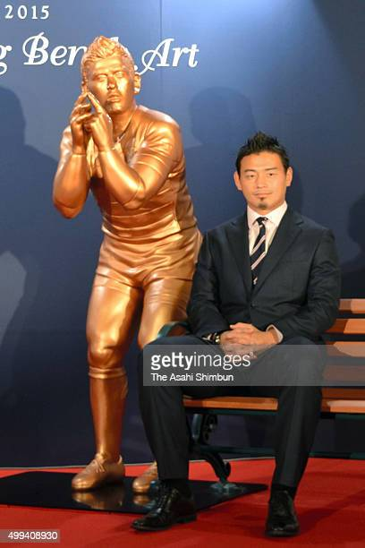 Rugby player Ayumu Goromaru poses with his lifesize statue during its unveiling as a part of the Tokyo Michiterasu 2015 on November 30 2015 in Tokyo...