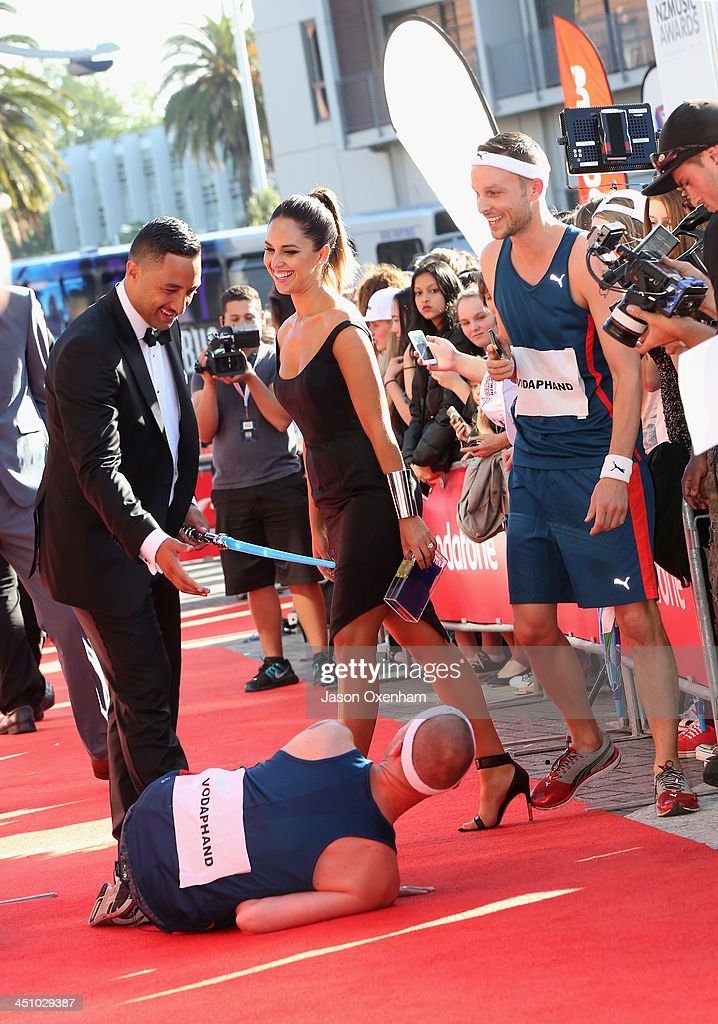 Rugby player <a gi-track='captionPersonalityLinkClicked' href=/galleries/search?phrase=Benji+Marshall&family=editorial&specificpeople=215506 ng-click='$event.stopPropagation()'>Benji Marshall</a> knocks over comedian Jono Pryor on the red carpet at the New Zealand Music Awards at Vector Arena on November 21, 2013 in Auckland, New Zealand.