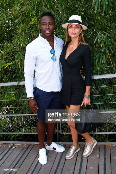 Rugby player Fulgence Ouedraogo and actress Ariane Brodier attend the 2017 French Tennis Open Day Height at Roland Garros on June 4 2017 in Paris...