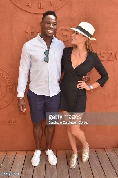Rugby player Fulgence Ouedraogo and Actress Ariane Brodier attend the 2017 French Tennis Open Day Nine at Roland Garros on June 5 2017 in Paris France