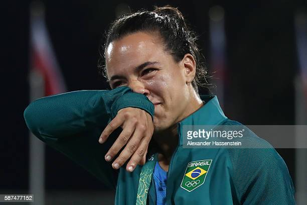 Rugby player Isadora Cerullo of Brazil reacts as volunteer Marjorie Enya proposing her marriage after the Women's Gold Medal Rugby Sevens match...