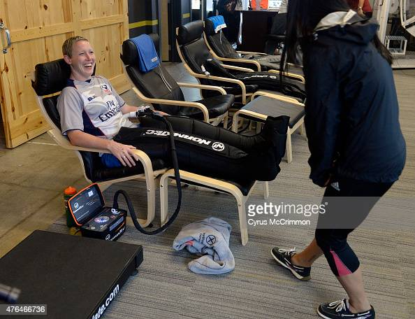 A rugby player Jillion Potter laughs with Lin Hill right as she receives treatment on her legs at the Denver Sports Recovery facility on Friday June...