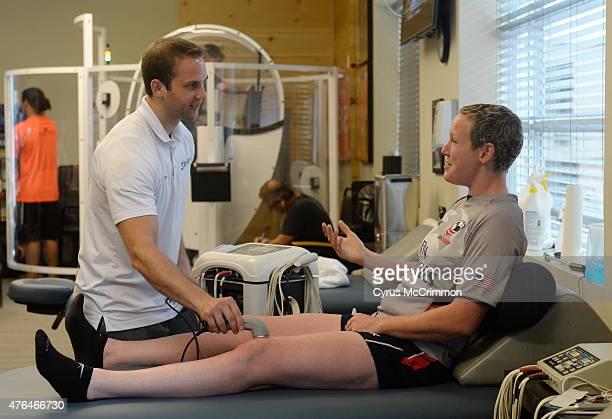 A rugby player Jillion Potter receives an ultra sound treatment on her legs by Chris Contini at the Denver Sports Recovery facility on Friday June 5...