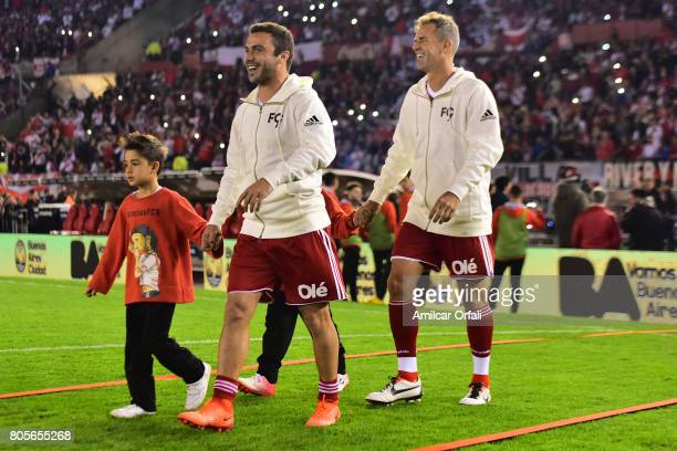 Rugby player of Argentina Martin Landajo and head coach of Argentina Davis cup Daniel Orsanic enter to the field prior Fernando Cavenaghi's farewell...
