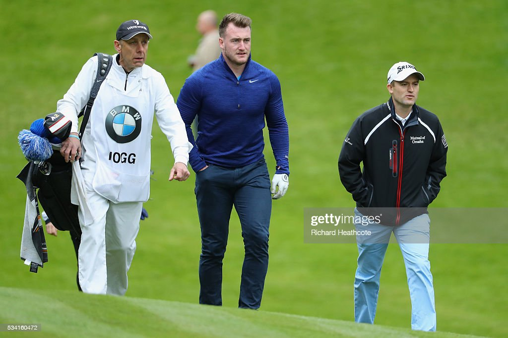 Rugby player Stuart Hogg and Russell Knox pf Scotland during the Pro-Am prior to the BMW PGA Championship at Wentworth on May 25, 2016 in Virginia Water, England.