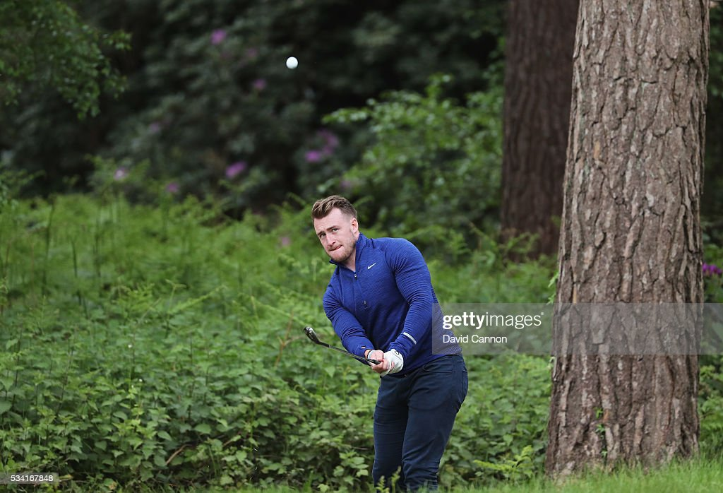 Rugby player Stuart Hogg chips during the Pro-Am prior to the BMW PGA Championship at Wentworth on May 25, 2016 in Virginia Water, England.