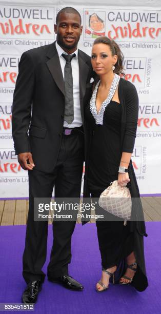 Rugby player Ugochukwu Monye and Rosie Caligi arrive for the Butterfly Ball in Battersea Park London The event by Caudwell Children aims to raise...