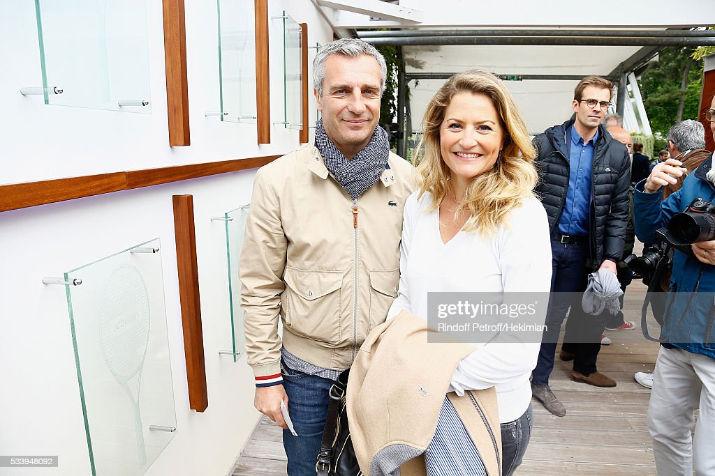 Rugby player <a gi-track='captionPersonalityLinkClicked' href=/galleries/search?phrase=Yann+Delaigue&family=editorial&specificpeople=224425 ng-click='$event.stopPropagation()'>Yann Delaigue</a> and journalist Astrid Bard attend the 2016 French Tennis Open - Day Three at Roland Garros on May 24, 2016 in Paris, France.