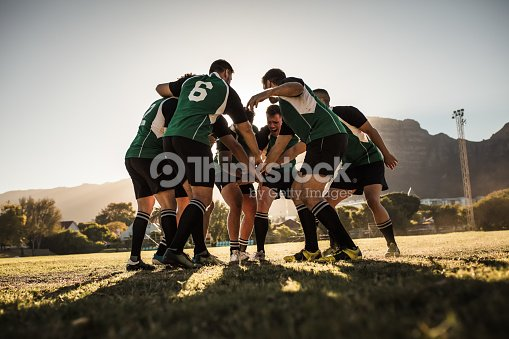 Rugby players cheering and celebrating win : Stock Photo