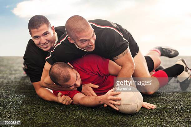 Rugby players in action.
