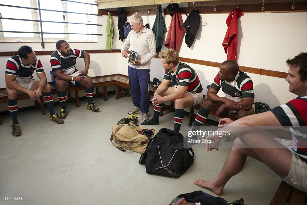 Rugby players in changing room : Stock Photo